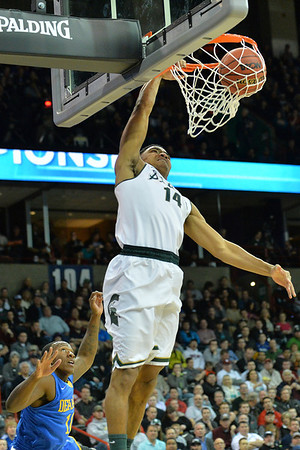 March 20, 2014: Michigan State Spartans guard Gary Harris (14) goes up for a dunk during a second round game of the NCAA Division I Men's Basketball Championship between the 4-seed Michigan State and the 13-seed Delaware at Spokane Arena in Spokane, Wash. Michigan State defeated Delaware 93-78.