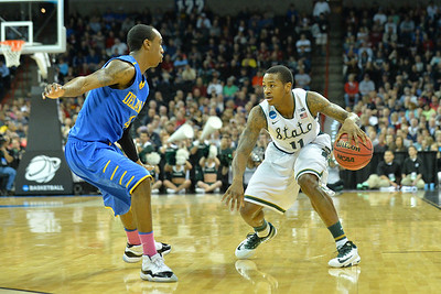 March 20, 2014: Michigan State Spartans guard Keith Appling (11) looks to get past Delaware Fightin' Blue Hens guard Jarvis Threatt (4) during a second round game of the NCAA Division I Men's Basketball Championship between the 4-seed Michigan State and the 13-seed Delaware at Spokane Arena in Spokane, Wash. Michigan State defeated Delaware 93-78.