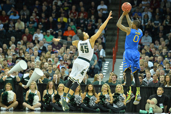 March 20, 2014: Michigan State Spartans guard Denzel Valentine (45) contests a shot by Delaware Fightin' Blue Hens guard Davon Usher (0) during a second round game of the NCAA Division I Men's Basketball Championship between the 4-seed Michigan State and the 13-seed Delaware at Spokane Arena in Spokane, Wash. Michigan State defeated Delaware 93-78.