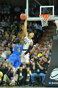 March 20, 2014: Michigan State Spartans guard Denzel Valentine (45) blocks a shot attempt from Delaware Fightin' Blue Hens guard Jarvis Threatt (4) during a second round game of the NCAA Division I Men's Basketball Championship between the 4-seed Michigan State and the 13-seed Delaware at Spokane Arena in Spokane, Wash. Michigan State defeated Delaware 93-78.