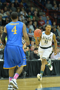 March 20, 2014: Michigan State Spartans guard Keith Appling (11) brings the ball up the floor during a second round game of the NCAA Division I Men's Basketball Championship between the 4-seed Michigan State and the 13-seed Delaware at Spokane Arena in Spokane, Wash. Michigan State defeated Delaware 93-78.