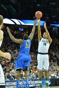 March 20, 2014: Michigan State Spartans guard Gary Harris (14) shoots over Delaware Fightin' Blue Hens guard Devon Saddler (10) during a second round game of the NCAA Division I Men's Basketball Championship between the 4-seed Michigan State and the 13-seed Delaware at Spokane Arena in Spokane, Wash. Michigan State defeated Delaware 93-78.