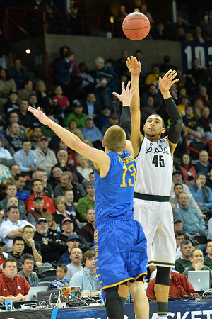 March 20, 2014: Michigan State Spartans guard Denzel Valentine (45) shoots over Delaware Fightin' Blue Hens guard Kyle Anderson (13) during a second round game of the NCAA Division I Men's Basketball Championship between the 4-seed Michigan State and the 13-seed Delaware at Spokane Arena in Spokane, Wash. Michigan State defeated Delaware 93-78.
