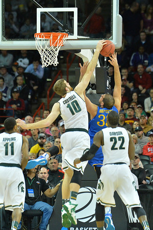 March 20, 2014: Michigan State Spartans forward Matt Costello (10) blocks a shot attempts from Delaware Fightin' Blue Hens forward Carl Baptiste (33) during a second round game of the NCAA Division I Men's Basketball Championship between the 4-seed Michigan State and the 13-seed Delaware at Spokane Arena in Spokane, Wash. Michigan State defeated Delaware 93-78.