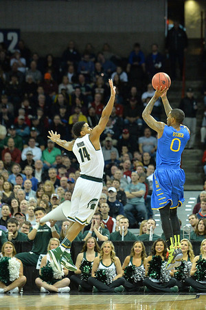 March 20, 2014: Delaware Fightin' Blue Hens guard Davon Usher (0) shoots a three pointer over Michigan State Spartans guard Gary Harris (14) during a second round game of the NCAA Division I Men's Basketball Championship between the 4-seed Michigan State and the 13-seed Delaware at Spokane Arena in Spokane, Wash. Michigan State defeated Delaware 93-78.