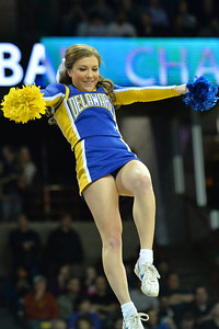 March 20, 2014: A Delaware Fightin' Blue Hens cheerleader performs during a second round game of the NCAA Division I Men's Basketball Championship between the 4-seed Michigan State and the 13-seed Delaware at Spokane Arena in Spokane, Wash. Michigan State defeated Delaware 93-78.