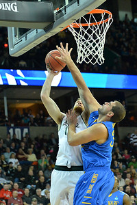 March 20, 2014: Delaware Fightin' Blue Hens forward Carl Baptiste (33) contests a shot from Michigan State Spartans forward Matt Costello (10) during a second round game of the NCAA Division I Men's Basketball Championship between the 4-seed Michigan State and the 13-seed Delaware at Spokane Arena in Spokane, Wash. Michigan State defeated Delaware 93-78.