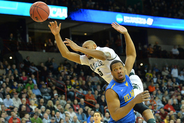 March 20, 2014: Michigan State Spartans forward Adreian Payne (5) loses control of the ball during a second round game of the NCAA Division I Men's Basketball Championship between the 4-seed Michigan State and the 13-seed Delaware at Spokane Arena in Spokane, Wash. Michigan State defeated Delaware 93-78.