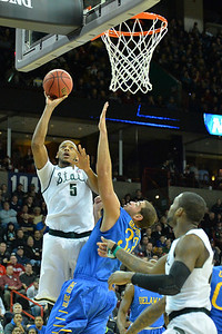 March 20, 2014: Michigan State Spartans forward Adreian Payne (5) puts up a layup over Delaware Fightin' Blue Hens forward Carl Baptiste (33) during a second round game of the NCAA Division I Men's Basketball Championship between the 4-seed Michigan State and the 13-seed Delaware at Spokane Arena in Spokane, Wash. Michigan State defeated Delaware 93-78.
