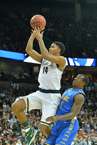 March 20, 2014: Michigan State Spartans guard Gary Harris (14) gets past Delaware Fightin' Blue Hens guard Davon Usher (0) for a shot attempt during a second round game of the NCAA Division I Men's Basketball Championship between the 4-seed Michigan State and the 13-seed Delaware at Spokane Arena in Spokane, Wash. Michigan State defeated Delaware 93-78.
