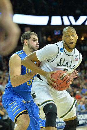 March 20, 2014: Michigan State Spartans forward Adreian Payne (5) battles in the paint during a second round game of the NCAA Division I Men's Basketball Championship between the 4-seed Michigan State and the 13-seed Delaware at Spokane Arena in Spokane, Wash. Michigan State defeated Delaware 93-78.