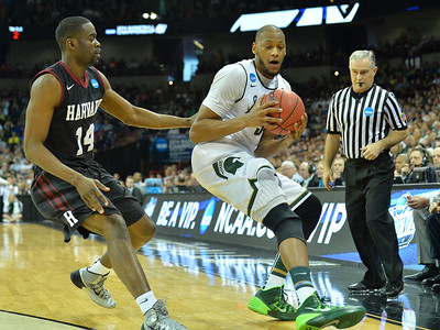 March 22, 2014: Michigan State Spartans forward Adreian Payne (5) corrals a loose ball during a third round game of the NCAA Division I Men's Basketball Championship between the 4-seed Michigan State and the 12-seed Harvard at Spokane Arena in Spokane, Wash. Michigan State defeated Harvard 80-73 to advance to the Sweet Sixteen.