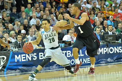 March 22, 2014: Michigan State Spartans guard Travis Trice (20) fends off the defense of Harvard Crimson guard Siyani Chambers (1) during a third round game of the NCAA Division I Men's Basketball Championship between the 4-seed Michigan State and the 12-seed Harvard at Spokane Arena in Spokane, Wash. Michigan State defeated Harvard 80-73 to advance to the Sweet Sixteen.