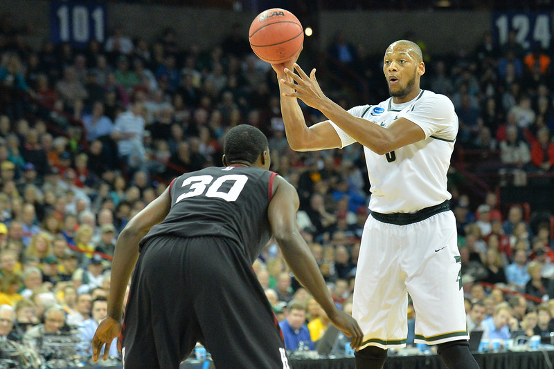 March 22, 2014: Michigan State Spartans forward Adreian Payne (5) looks for a teammate to pass to during a third round game of the NCAA Division I Men's Basketball Championship between the 4-seed Michigan State and the 12-seed Harvard at Spokane Arena in Spokane, Wash. Michigan State defeated Harvard 80-73 to advance to the Sweet Sixteen.