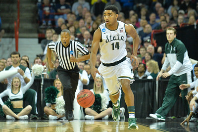 March 22, 2014: Michigan State Spartans guard Gary Harris (14) brings the ball up the court during a third round game of the NCAA Division I Men's Basketball Championship between the 4-seed Michigan State and the 12-seed Harvard at Spokane Arena in Spokane, Wash. Michigan State defeated Harvard 80-73 to advance to the Sweet Sixteen.