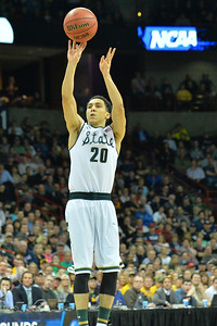 March 22, 2014: Michigan State Spartans guard Travis Trice (20) shoots a jumper during a third round game of the NCAA Division I Men's Basketball Championship between the 4-seed Michigan State and the 12-seed Harvard at Spokane Arena in Spokane, Wash. Michigan State defeated Harvard 80-73 to advance to the Sweet Sixteen.