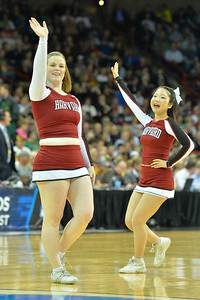 March 22, 2014: Harvard Crimson cheerleaders perform during a third round game of the NCAA Division I Men's Basketball Championship between the 4-seed Michigan State and the 12-seed Harvard at Spokane Arena in Spokane, Wash. Michigan State defeated Harvard 80-73 to advance to the Sweet Sixteen.