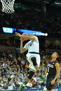 March 22, 2014: Michigan State Spartans forward Adreian Payne (5) puts up a shot during a third round game of the NCAA Division I Men's Basketball Championship between the 4-seed Michigan State and the 12-seed Harvard at Spokane Arena in Spokane, Wash. Michigan State defeated Harvard 80-73 to advance to the Sweet Sixteen.