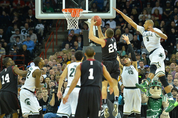March 22, 2014: Harvard Crimson forward Jonah Travis (24) puts up a shot during a third round game of the NCAA Division I Men's Basketball Championship between the 4-seed Michigan State and the 12-seed Harvard at Spokane Arena in Spokane, Wash. Michigan State defeated Harvard 80-73 to advance to the Sweet Sixteen.