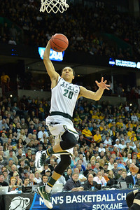 March 22, 2014: Michigan State Spartans guard Travis Trice (20) goes up for a dunk during a third round game of the NCAA Division I Men's Basketball Championship between the 4-seed Michigan State and the 12-seed Harvard at Spokane Arena in Spokane, Wash. Michigan State defeated Harvard 80-73 to advance to the Sweet Sixteen.