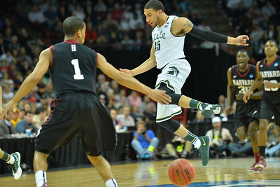 March 22, 2014: Michigan State Spartans guard Denzel Valentine (45) loses the ball during a third round game of the NCAA Division I Men's Basketball Championship between the 4-seed Michigan State and the 12-seed Harvard at Spokane Arena in Spokane, Wash. Michigan State defeated Harvard 80-73 to advance to the Sweet Sixteen.