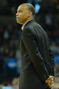 March 22, 2014: Harvard Crimson head coach Tommy Amaker watches the action during a third round game of the NCAA Division I Men's Basketball Championship between the 4-seed Michigan State and the 12-seed Harvard at Spokane Arena in Spokane, Wash. Michigan State defeated Harvard 80-73 to advance to the Sweet Sixteen.