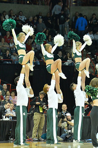March 22, 2014: Michigan State Spartans cheerleaders perform during a third round game of the NCAA Division I Men's Basketball Championship between the 4-seed Michigan State and the 12-seed Harvard at Spokane Arena in Spokane, Wash. Michigan State defeated Harvard 80-73 to advance to the Sweet Sixteen.