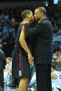 March 22, 2014: Harvard Crimson head coach Tommy Amaker talks to Harvard Crimson guard Siyani Chambers (1) in a timeout during a third round game of the NCAA Division I Men's Basketball Championship between the 4-seed Michigan State and the 12-seed Harvard at Spokane Arena in Spokane, Wash. Michigan State defeated Harvard 80-73 to advance to the Sweet Sixteen.