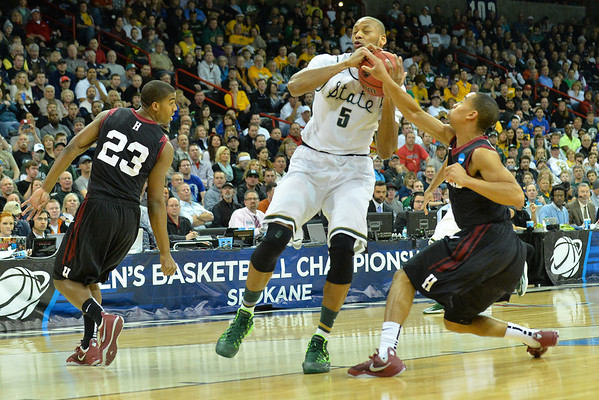 March 22, 2014: Michigan State Spartans forward Adreian Payne (5) tries to control the ball on a fast break during a third round game of the NCAA Division I Men's Basketball Championship between the 4-seed Michigan State and the 12-seed Harvard at Spokane Arena in Spokane, Wash. Michigan State defeated Harvard 80-73 to advance to the Sweet Sixteen.