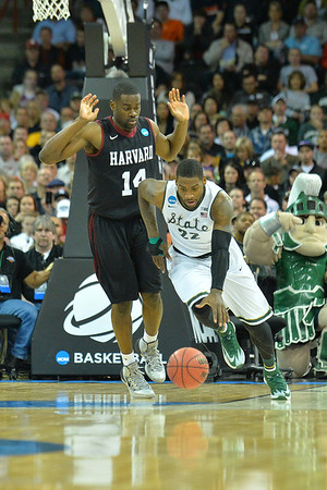 March 22, 2014: Michigan State Spartans guard/forward Branden Dawson (22) brings the ball up the court on a fast break during a third round game of the NCAA Division I Men's Basketball Championship between the 4-seed Michigan State and the 12-seed Harvard at Spokane Arena in Spokane, Wash. Michigan State defeated Harvard 80-73 to advance to the Sweet Sixteen.