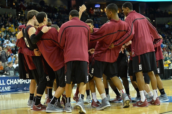 March 22, 2014: The Harvard Crimson team huddles before tip-off of a third round game of the NCAA Division I Men's Basketball Championship between the 4-seed Michigan State and the 12-seed Harvard at Spokane Arena in Spokane, Wash. Michigan State defeated Harvard 80-73 to advance to the Sweet Sixteen.