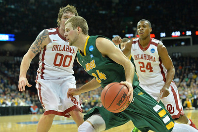March 20, 2014: North Dakota State Bison guard Taylor Braun (24) drives the baseline during a second round game of the NCAA Division I Men's Basketball Championship between the 5-seed Oklahoma and the 12-seed North Dakota State at Spokane Arena in Spokane, Wash. North Dakota State defeated Oklahoma 80-75 in overtime.