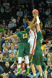 March 20, 2014: North Dakota State Bison guard Lawrence Alexander (12) contests a shot by Oklahoma Sooners guard Buddy Hield (24) during a second round game of the NCAA Division I Men's Basketball Championship between the 5-seed Oklahoma and the 12-seed North Dakota State at Spokane Arena in Spokane, Wash. North Dakota State defeated Oklahoma 80-75 in overtime.