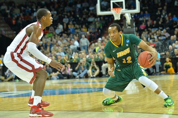 March 20, 2014: North Dakota State Bison guard Lawrence Alexander (12) looks to drive during a second round game of the NCAA Division I Men's Basketball Championship between the 5-seed Oklahoma and the 12-seed North Dakota State at Spokane Arena in Spokane, Wash. North Dakota State defeated Oklahoma 80-75 in overtime.