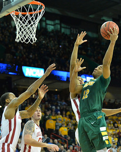 March 20, 2014: North Dakota State Bison guard Lawrence Alexander (12) puts up a shot during a second round game of the NCAA Division I Men's Basketball Championship between the 5-seed Oklahoma and the 12-seed North Dakota State at Spokane Arena in Spokane, Wash. North Dakota State defeated Oklahoma 80-75 in overtime.