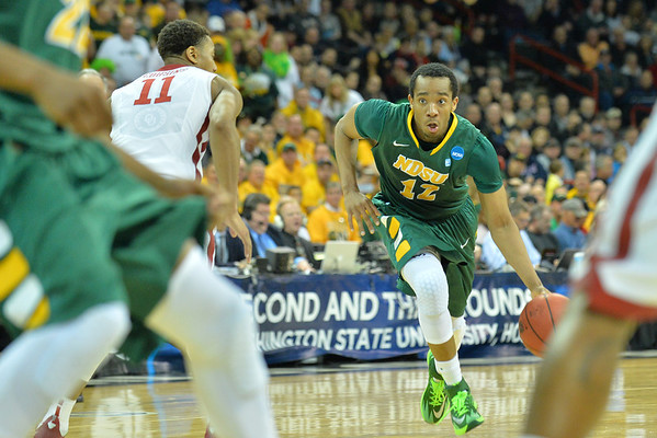 March 20, 2014: North Dakota State Bison guard Lawrence Alexander (12) drives during a second round game of the NCAA Division I Men's Basketball Championship between the 5-seed Oklahoma and the 12-seed North Dakota State at Spokane Arena in Spokane, Wash. North Dakota State defeated Oklahoma 80-75 in overtime.