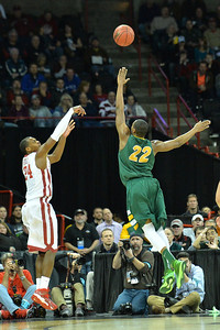 March 20, 2014: Oklahoma Sooners guard Buddy Hield (24) shoots a three pointer over North Dakota State Bison guard Kory Brown (22) during a second round game of the NCAA Division I Men's Basketball Championship between the 5-seed Oklahoma and the 12-seed North Dakota State at Spokane Arena in Spokane, Wash. North Dakota State defeated Oklahoma 80-75 in overtime.