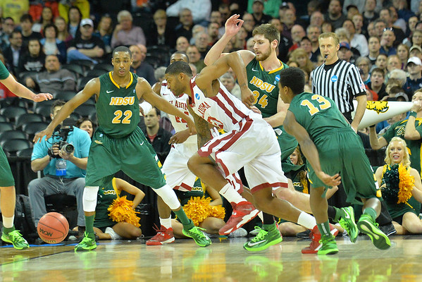 March 20, 2014: Oklahoma Sooners forward Cameron Clark (21) chases down a loose ball during a second round game of the NCAA Division I Men's Basketball Championship between the 5-seed Oklahoma and the 12-seed North Dakota State at Spokane Arena in Spokane, Wash. North Dakota State defeated Oklahoma 80-75 in overtime.