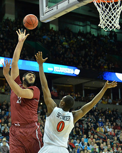 March 20, 2014: New Mexico State Aggies center Sim Bhullar (2) shoots over San Diego State Aztecs forward Skylar Spencer (0) during a second round game of the NCAA Division I Men's Basketball Championship between the 4-seed San Diego State Aztecs and the 13-seed New Mexico State Aggies at Spokane Arena in Spokane, Wash. San Diego State defeated New Mexico State 73-69 in overtime.