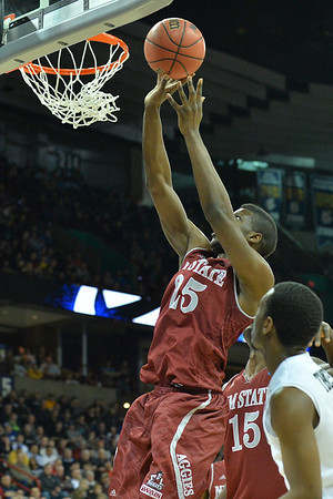 March 20, 2014: New Mexico State Aggies forward Renaldo Dixon (25) puts up a shot during a second round game of the NCAA Division I Men's Basketball Championship between the 4-seed San Diego State Aztecs and the 13-seed New Mexico State Aggies at Spokane Arena in Spokane, Wash. San Diego State defeated New Mexico State 73-69 in overtime.