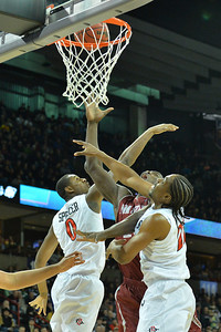 March 20, 2014: New Mexico State Aggies center Tshilidzi Nephawe (15) battles San Diego State Aztecs forward Skylar Spencer (0) and San Diego State Aztecs forward Josh Davis (22) for a rebound during a second round game of the NCAA Division I Men's Basketball Championship between the 4-seed San Diego State Aztecs and the 13-seed New Mexico State Aggies at Spokane Arena in Spokane, Wash. San Diego State defeated New Mexico State 73-69 in overtime.