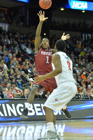 March 20, 2014: New Mexico State Aggies guard DK Eldridge (1) throws an alley-oop pass during a second round game of the NCAA Division I Men's Basketball Championship between the 4-seed San Diego State Aztecs and the 13-seed New Mexico State Aggies at Spokane Arena in Spokane, Wash. San Diego State defeated New Mexico State 73-69 in overtime.