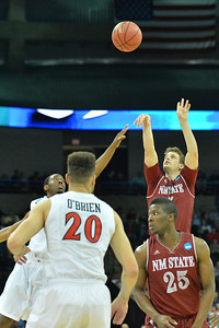 March 20, 2014: New Mexico State Aggies guard Kevin Aronis (5) shoots a three pointer during a second round game of the NCAA Division I Men's Basketball Championship between the 4-seed San Diego State Aztecs and the 13-seed New Mexico State Aggies at Spokane Arena in Spokane, Wash. San Diego State defeated New Mexico State 73-69 in overtime.