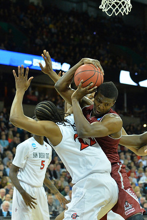 March 20, 2014: New Mexico State Aggies forward Renaldo Dixon (25) grabs a rebound during a second round game of the NCAA Division I Men's Basketball Championship between the 4-seed San Diego State Aztecs and the 13-seed New Mexico State Aggies at Spokane Arena in Spokane, Wash. San Diego State defeated New Mexico State 73-69 in overtime.