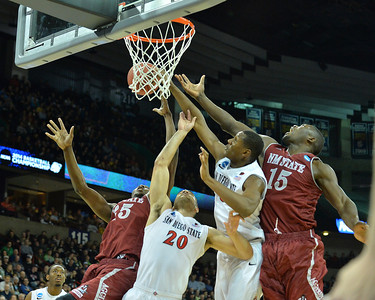 March 20, 2014: New Mexico State Aggies center Tshilidzi Nephawe (15) and New Mexico State Aggies forward Renaldo Dixon (25) battle San Diego State Aztecs forward JJ O'Brien (20) and San Diego State Aztecs forward Skylar Spencer (0) for a rebound during a second round game of the NCAA Division I Men's Basketball Championship between the 4-seed San Diego State Aztecs and the 13-seed New Mexico State Aggies at Spokane Arena in Spokane, Wash. San Diego State defeated New Mexico State 73-69 in overtime.