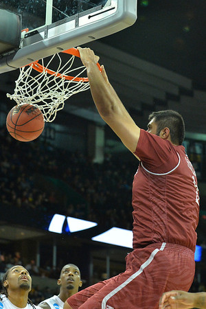 March 20, 2014: New Mexico State Aggies center Sim Bhullar (2) dunks during a second round game of the NCAA Division I Men's Basketball Championship between the 4-seed San Diego State Aztecs and the 13-seed New Mexico State Aggies at Spokane Arena in Spokane, Wash. San Diego State defeated New Mexico State 73-69 in overtime.