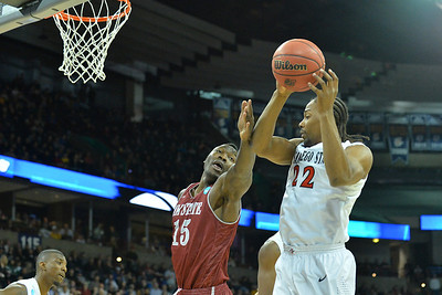 March 20, 2014: New Mexico State Aggies center Tshilidzi Nephawe (15) battles for a rebound against San Diego State Aztecs forward Josh Davis (22) during a second round game of the NCAA Division I Men's Basketball Championship between the 4-seed San Diego State Aztecs and the 13-seed New Mexico State Aggies at Spokane Arena in Spokane, Wash. San Diego State defeated New Mexico State 73-69 in overtime.