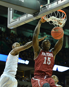 March 20, 2014: New Mexico State Aggies center Tshilidzi Nephawe (15) gets a dunk during a second round game of the NCAA Division I Men's Basketball Championship between the 4-seed San Diego State Aztecs and the 13-seed New Mexico State Aggies at Spokane Arena in Spokane, Wash. San Diego State defeated New Mexico State 73-69 in overtime.