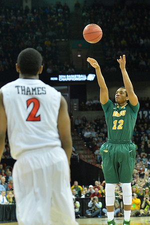March 22, 2014: North Dakota State Bison guard Lawrence Alexander (12) shoots a three pointer during a third round game of the NCAA Division I Men's Basketball Championship between the 4-seed San Diego State and the 12-seed North Dakota State at Spokane Arena in Spokane, Wash. San Diego State defeated North Dakota State 66-43 to advance to the Sweet Sixteen.