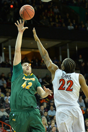 March 22, 2014: North Dakota State Bison forward Marshall Bjorklund (42) shoots over San Diego State Aztecs forward Josh Davis (22) during a third round game of the NCAA Division I Men's Basketball Championship between the 4-seed San Diego State and the 12-seed North Dakota State at Spokane Arena in Spokane, Wash. San Diego State defeated North Dakota State 66-43 to advance to the Sweet Sixteen.